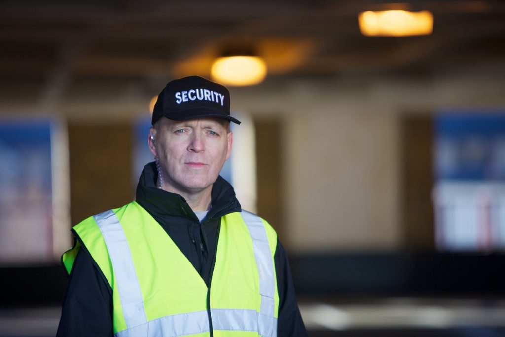 Security guard with black cap
